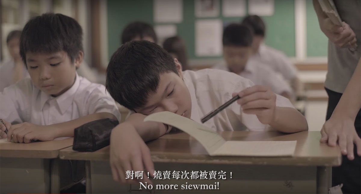 In the film, Siew Man is either misbehaving or sleeping in class, as if he is out of place.